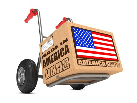 Photo pour Cardboard Box with Flag of USA and Made in America Slogan. Free Shipping Concept. - image libre de droit
