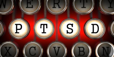 Foto de PTSD on Old Typewriter's Keys on Red Background. - Imagen libre de derechos