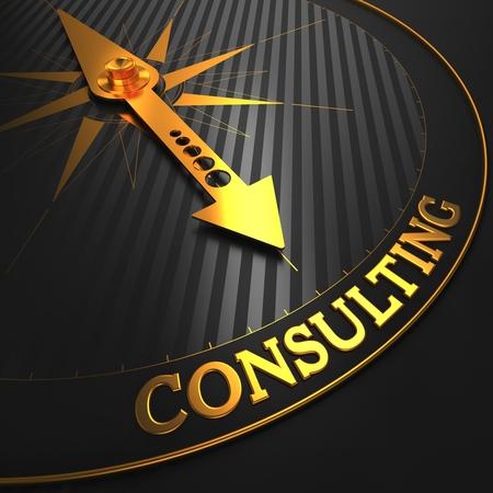 Photo pour Consulting - Golden Compass Needle on a Black Field Pointing. - image libre de droit