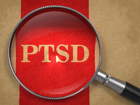 Foto de PTSD through Magnifying Glass on Old Paper with Red Vertical Line. - Imagen libre de derechos