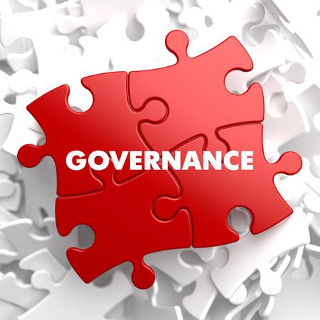 Foto de Governance on Red Puzzle on White Background. - Imagen libre de derechos
