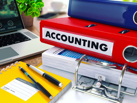 Foto de Accounting - Red Ring Binder on Office Desktop with Office Supplies and Modern Laptop. Business Concept on Blurred Background. Toned Illustration. - Imagen libre de derechos