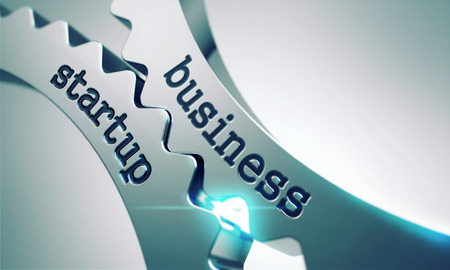 Foto de Business Startup on the Mechanism of Metal Cogwheels. - Imagen libre de derechos