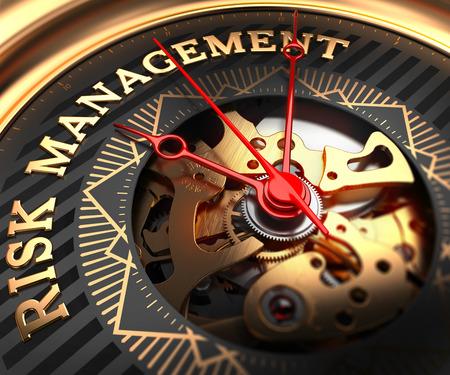 Foto de Risk Management on Black-Golden Watch Face with Closeup View of Watch Mechanism. - Imagen libre de derechos