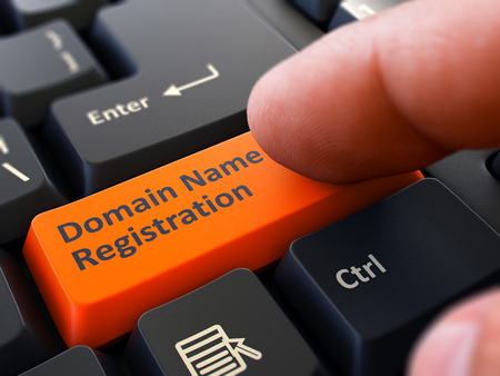 Photo for Finger Presses Orange Button  Domain Name Registration on Black Keyboard Background. Closeup View. Selective Focus. - Royalty Free Image