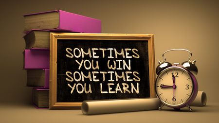 Photo for Sometimes You Win, Sometimes You Learn - Motivational Quote on Chalkboard with Hand Drawn Text, Stack of Books, Alarm Clock and Rolls of Paper on Blurred Background. Toned Image. - Royalty Free Image