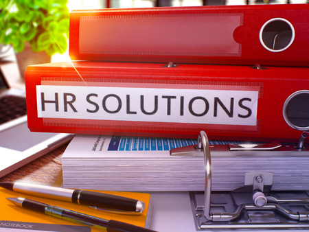 Photo for Red Ring Binder with Inscription HR - Human Resource - Solutions on Background of Working Table with Office Supplies and Laptop. HR Solutions Business Concept on Blurred Background. 3D Render. - Royalty Free Image