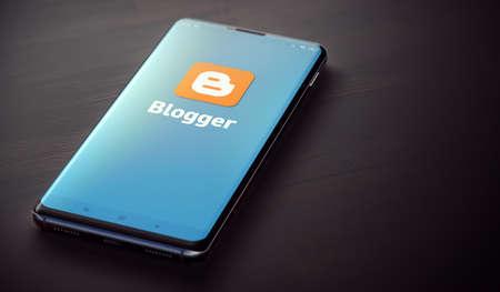 Foto de KYIV, UKRAINE-JUNE, 2020: Blogger Mobile Application on the Smartphone Screen. Close Up Studio Shot of Smartphone with Blogger Application. - Imagen libre de derechos