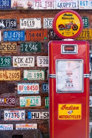 Photo for UTAH, UNITED STATES - NOVEMBER 16, 2008  Various old American license plates behind antique gas pump in rural Utah - Royalty Free Image
