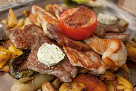 Plate with grilled meat and chicken in local Croatian restaurant