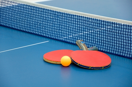 table tennis paddles and ball