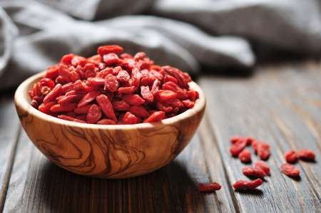 Photo for wooden bowl with goji berries on the table closeup - Royalty Free Image