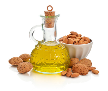 Photo for Almonds oil in bottle isolated on white background - Royalty Free Image