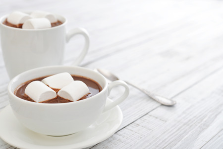 Photo for Mug with hot chocolate and marshmallows on wooden table - Royalty Free Image