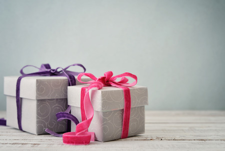 Photo for Gift boxes with violet and pink ribbons on blue background - Royalty Free Image