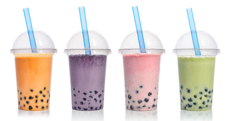 Foto de Various Bubble Tea in a plastic cups with drink straws isolated on white background. Take away drinks concept. - Imagen libre de derechos