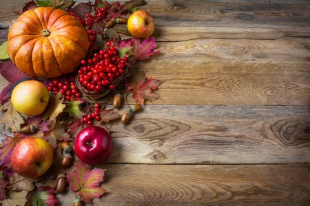 Photo for Thanksgiving  greeting background with pumpkins, apples and fall leaves. Thanksgiving background with seasonal vegetables and fruits. - Royalty Free Image