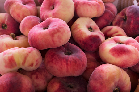 Photo for Fresh red donut peach background as abundance harvest symbol. Vegetarian food concept with ripe fruits - Royalty Free Image