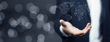 Foto de businessman holding world map in hands - Imagen libre de derechos
