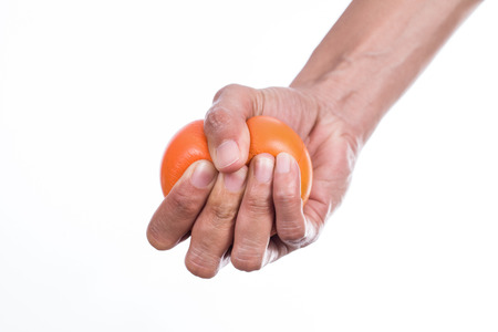 Foto per Hands of a woman squeezing a stress ball - Immagine Royalty Free