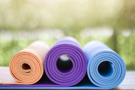 Photo for many yoga mats on the wood table in the garden - Royalty Free Image