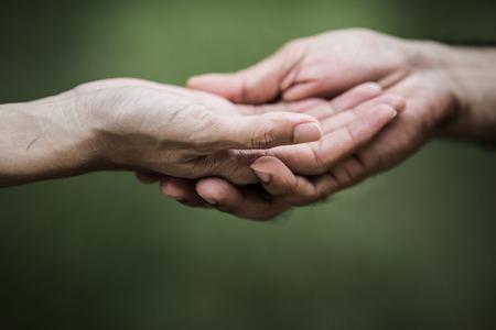 Foto de Giving a helping hand to another - Imagen libre de derechos