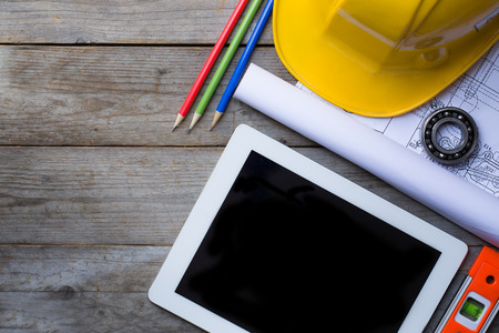 Photo pour Tablet computer with architecture and construction tools - image libre de droit