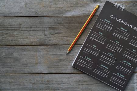 Photo for close up of calendar and pencil on the table, planning for business meeting or travel planning concept - Royalty Free Image