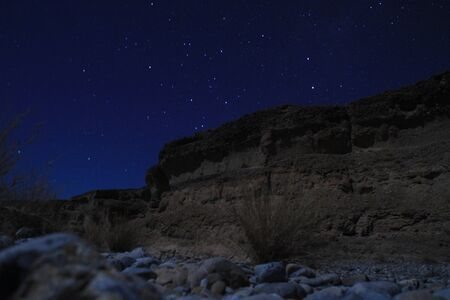 Photo for Sesriem Canyon, a natural gorge carved by the powerful Tsauchab River millions of years ago. Night landscape of the canyon with stars. - Royalty Free Image