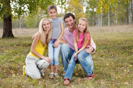 Happy family with children in autumn park