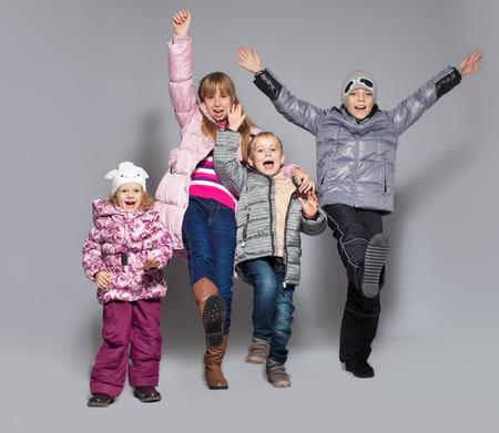 Photo pour Children in winter clothes. Kids in down jackets. Fashion child - image libre de droit