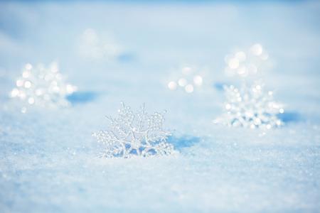 Foto de Winter background. Snowflakes on snow - Imagen libre de derechos