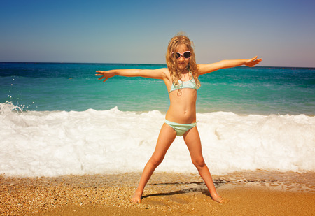 Photo for Child on the beach. Girl at vacations on sea - Royalty Free Image