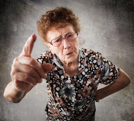 Foto de Scolded the old woman. Senior gives instruction. Anger grandmother - Imagen libre de derechos