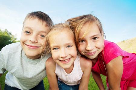 Happy children outdoors. Friends at summer