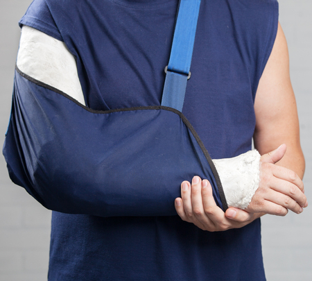 Photo pour Man with a plaster. Broken arm, shoulder. Injury - image libre de droit