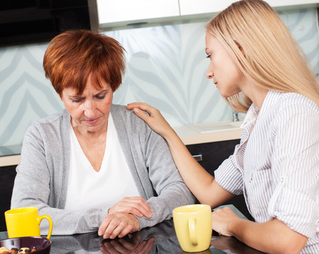 Photo for Daughter soothes sad mother. Young woman calm mature woman - Royalty Free Image