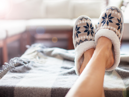 Photo for Slippers on women's legs. Soft comfortable home slipper - Royalty Free Image