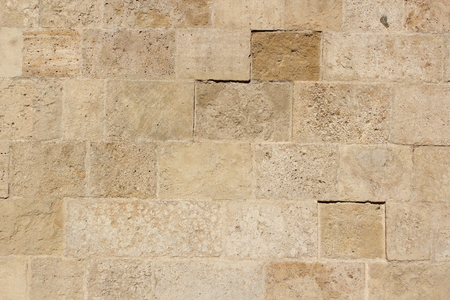 Foto de old stone tiles texture on exterior wall of a church - Imagen libre de derechos