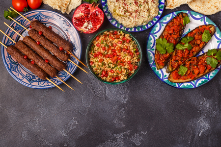Photo pour Classic kebabs, tabbouleh salad, baba ganush and baked eggplant with sauce. Traditional middle eastern or arab dish. Top view. - image libre de droit
