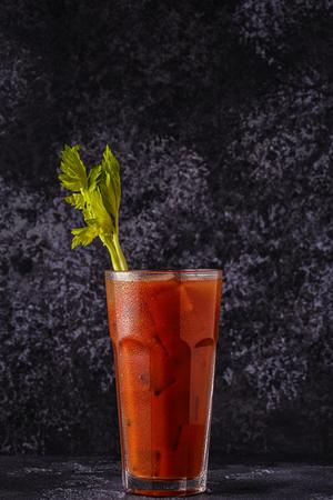 Foto de Classic cocktail - Bloody Mary on a dark background. - Imagen libre de derechos