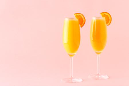 Foto de Yellow cocktail on a bright background, selective focus. - Imagen libre de derechos