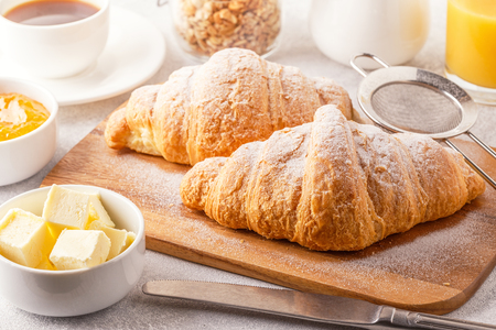 Photo for Continental breakfast with fresh croissants, orange juice and coffee, selective focuse. - Royalty Free Image