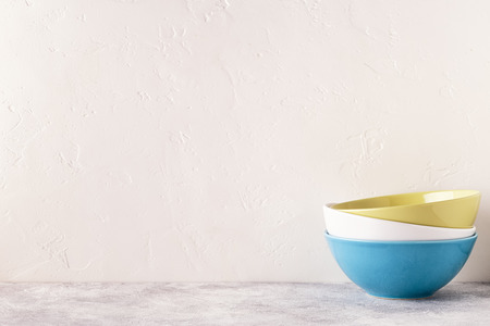 Photo pour Crockery and cutlery on a light table with copy space. - image libre de droit