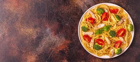 Photo pour Plate of spaghetti tomato broccoli chicken,  concept of  healthy diet food - image libre de droit