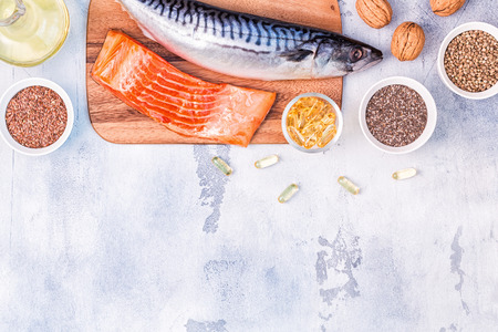 Photo for Sources of omega 3 - mackerel, salmon, flax seeds, hemp seeds, chia, walnuts, flaxseed oil. Healthy eating concept. Top view with copy space. - Royalty Free Image