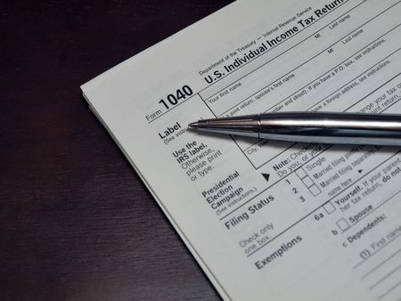 US 1040 Income Tax Form for tax preparation and accounting services related subject matter.