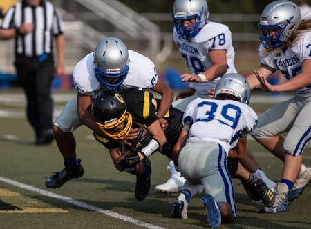 Photo pour Football action with McQueen High School vs. Enterprise in Redding, California. - image libre de droit