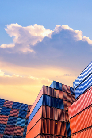 Foto de Colourful stack pattern of cargo shipping containers in shipping yard,dock yard for transportation,import,export industrial concept - Imagen libre de derechos