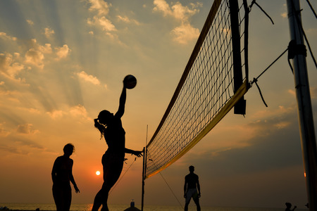 Photo pour Beach volleyball silhouette at sunset , motion blurred - image libre de droit